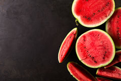 Slice watermelon. On black background. top view. Left space for text Royalty Free Stock Image