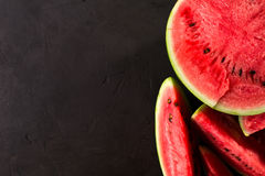 Slice watermelon. On black background. top view. Left space for text Stock Photography