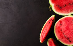 Slice watermelon. On black background. top view. Left space for text Stock Images