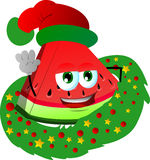 A slice of watermelon with Christmas wreath and Santa hat Stock Images