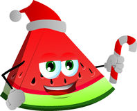 A slice of watermelon holding a candy cane and wearing Santa's hat Stock Photography