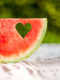Slice watermelon with a hole in the shape of heart Royalty Free Stock Images