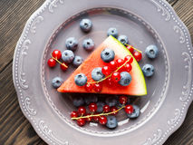 Slice of watermelon pizza cake with berries Stock Photo