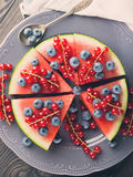 Slice of watermelon pizza cake with berries Stock Image