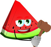 A slice of watermelon with a wooden hammer Stock Photo