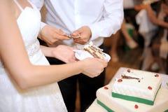 Slice of Wedding Cake. Bride and groom taking slice of wedding cake Stock Photography
