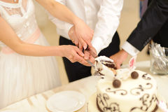 Slice of Wedding Cake. Bride and groom cutting wedding cake together Royalty Free Stock Image