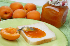Slice of white bread with apricot jam. On table Stock Photos