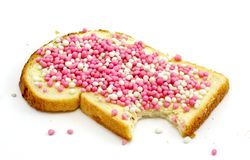 Slice of white bread and little colored balls Royalty Free Stock Photos