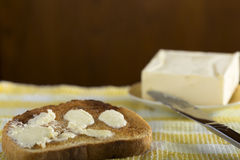 Slice of white buttered toast Royalty Free Stock Photo