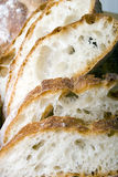 Slice of white Italian brick oven fresh bread. Slice of white Italian brick oven delicious fresh baked bread stock photography