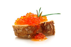 Slice of whole grain bread with red caviar. Royalty Free Stock Photography