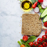 Slice of a whole wheat bread and healthy food Royalty Free Stock Photos