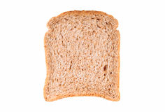 Slice of wholemeal bread. Over white background Royalty Free Stock Photo