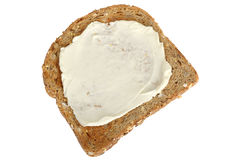 Slice of Wholemeal Toast Spread with Soft Cheese. Isolated white background Stock Photography