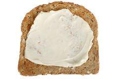 Slice of Wholemeal Toast Spread with Soft Cheese Stock Images