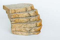 Slice of wholewheat bread isolated on white background Stock Photos