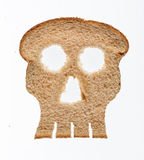 Slice of wholewheat bread in shape of skull Royalty Free Stock Image