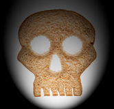 Slice of wholewheat bread in shape of skull Stock Photo