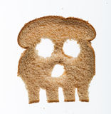 Slice of wholewheat bread in shape of skull Royalty Free Stock Images