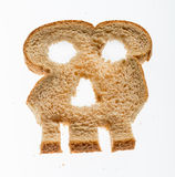 Slice of wholewheat bread in shape of skull Stock Photography