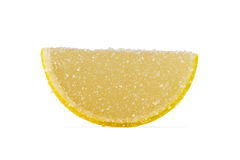 Slice Of Yellow Marmalade On A White Background. Slice of yellow marmalade sprinkled with granulated sugar on a white background Royalty Free Stock Image