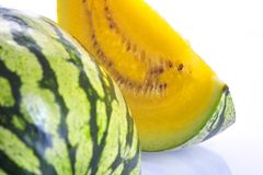 A slice of yellow watermelon. Yellow watermelon slice Stock Images