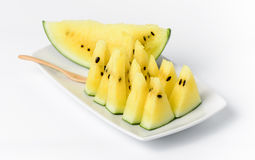 Slice yellow watermelon on dish isolated Stock Photography