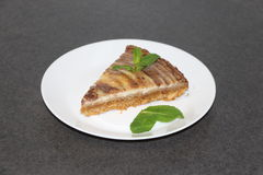 Slice of zebra cheese cake with mint leafs Royalty Free Stock Photo