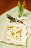 Slice of zucchini flowers tart Stock Photos