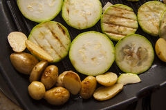 Slice of zucchini on pan Royalty Free Stock Photos