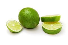 Sliced and whole lime Royalty Free Stock Photos