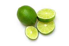 Sliced ​​and whole lime. Isolated on white background Royalty Free Stock Photo
