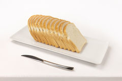 Sliced ​​bread on rectangular dish and a knife Stock Photography