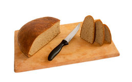 Sliced ​​bread. On a wooden board on a white background Stock Photo