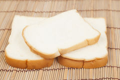 Sliced ​​bread on the wooden plate. Stock Photography