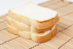 Sliced ​​bread on the wooden plate. Stock Photos