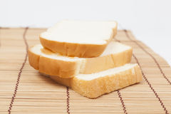 Sliced ​​bread on the wooden plate. Royalty Free Stock Photography