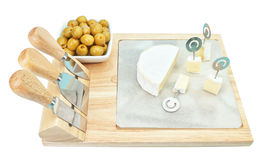 Sliced ��cheese cubes on a wooden board. Stock Image