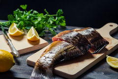 Sliced ​​fresh fish on the board before frying Stock Image