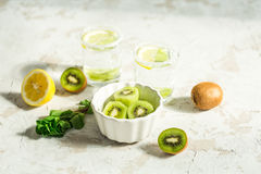 Sliced kiwi for a drink with mint and lemon Royalty Free Stock Photography