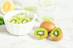 Sliced kiwi for a drink with mint and lemon Stock Photos