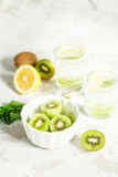 Sliced kiwi for a drink with mint and lemon Royalty Free Stock Images