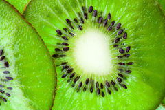 Sliced ​​kiwi illustrated in the whole frame Royalty Free Stock Photos