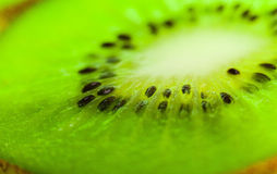Sliced ​​kiwi illustrated in the whole frame Royalty Free Stock Photography