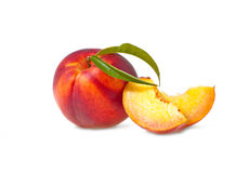 Sliced ​​peaches. Sliced ​​juicy peach with two slices Stock Photos