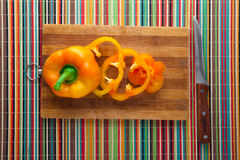Sliced peppers on board. Sliced yellow pepper on a kitchen board Royalty Free Stock Photos