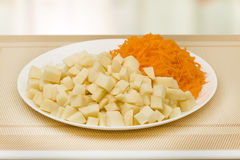 Sliced potatoes and grated carrots Royalty Free Stock Image