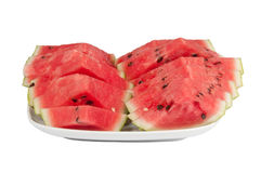 Sliced ​​watermelon on a large plate. On a white background Stock Photography