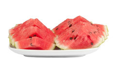 Sliced ​​watermelon on a large plate. On a white background Royalty Free Stock Photography